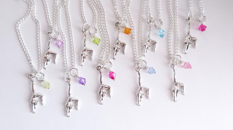 Gift your gymnastics party guests with a silver gymnastics necklace with gem stone.